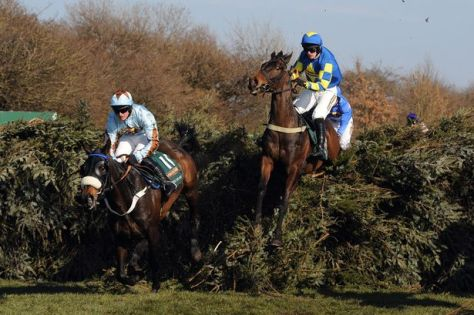 Auroras Encore (right) on his way to Grand National glory